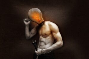 A human with a glowing light bulb instead of a head, holding a plug in one hand